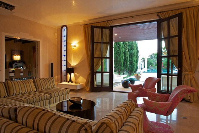 The luxurious lounge with views out towards the pool: Gary Golds