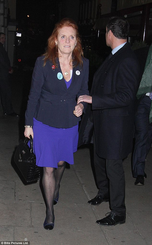The Duchess of York looked delighted as she left Loulous with Manuel Fernandez
