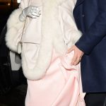 Joan Collins looked stunning in a pale pink gown embellished matching shoes with a butterfly motif
