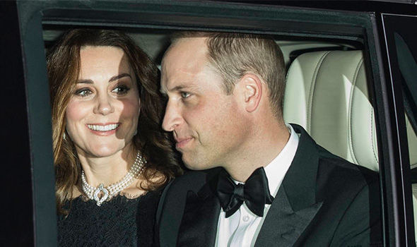 Kate Middleton sits between her brother in law Prince Harry and husband Prince William Photo C JONATHAN BUCKMASTER
