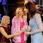 Kate chats to Sarah Hadland wearing a black and red floral dress and Sally Phillips wearing a pink faux fur coat and pink hot pink patterned dress after the show