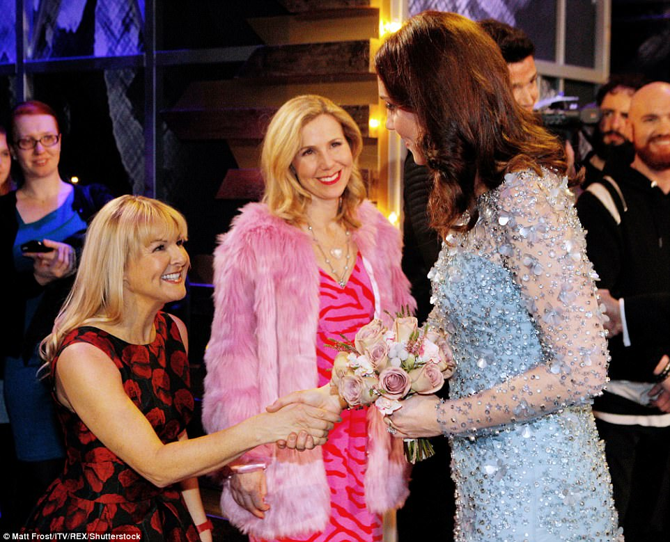 Kate chats to Sarah Hadland, wearing a black and red floral dress and Sally Phillips wearing a pink faux-fur coat and pink hot pink patterned dress after Kate chats to Sarah Hadland, wearing a black and red floral dress and Sally Phillips wearing a pink faux-fur coat and pink hot pink patterned dress after the showe show