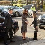 Kate displayed a hint of a baby bump in her designer dress as she arrived at the museum in a chauffeur driven car