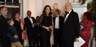 Kate looked effortlessly stylish in a black Diane Von Fursternberg gown AFP Getty
