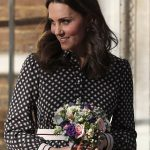 Kate looked resplendent as she left the centre armed with a chic collection of flowers from one of her admirers