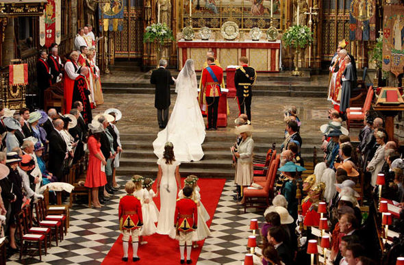 Kate walked down the aisle of the Abbey accompanied by her father Michael Middleton Photo (C) GETTY