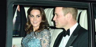 Kates growing baby bump was just visible under her embellished blue dress adorned with beads sequins and flowers