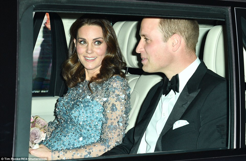 Kate's growing baby bump was just visible under her embellished blue dress, adorned with beads, sequins and flowers