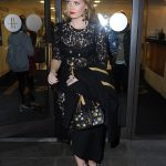 Kitty looked every inch the bombshell in a black lace Dolce Gabbana dress as she left