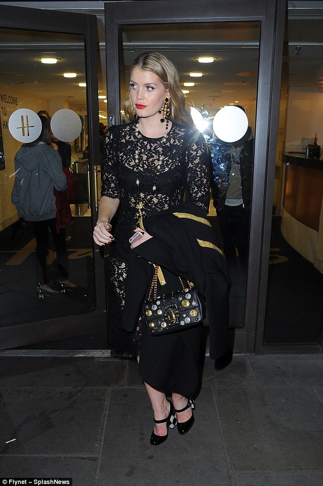 Kitty looked every inch the bombshell in a black lace Dolce & Gabbana dress as she left