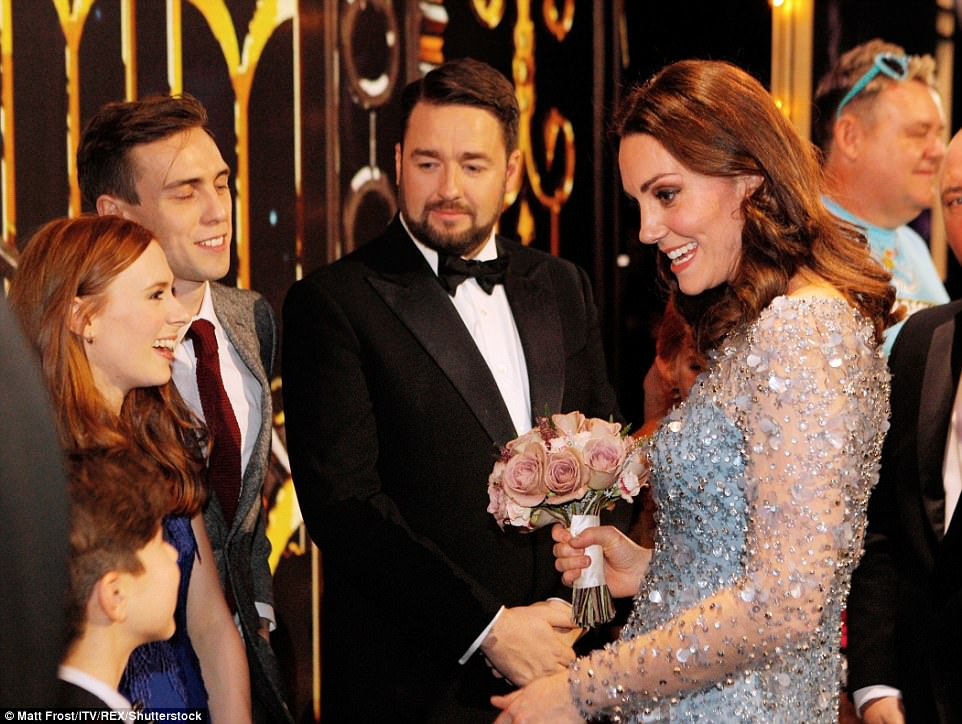 People smile as Kate greets them and chats enthusiastically with everyone after the show finished tonight in London