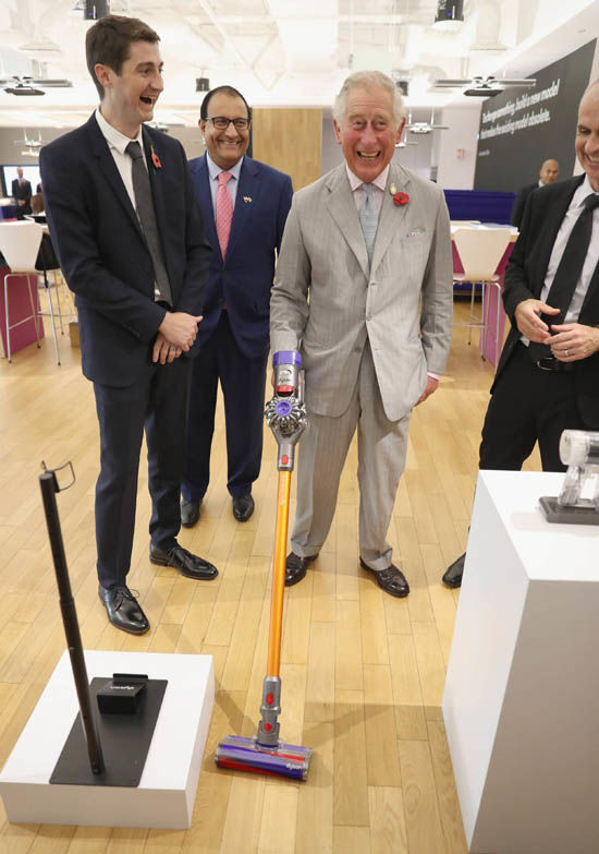 Prince Charles showed his expertise with a vacuum cleaner vacuuming vigorously the floor Photo (C) CHRIS JACKSON, PA IMAGE