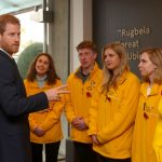Prince Harry meets with the Commonwealth War Grave Commission volunteers before the game Photo C ADAM DAVY PA WIRE AP