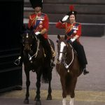 Queen Elizabeth II accompanied by the Duke of Edinburgh takes the salute outside Buckingham Palace at the conclusion of the Trooping the Colour ceremony