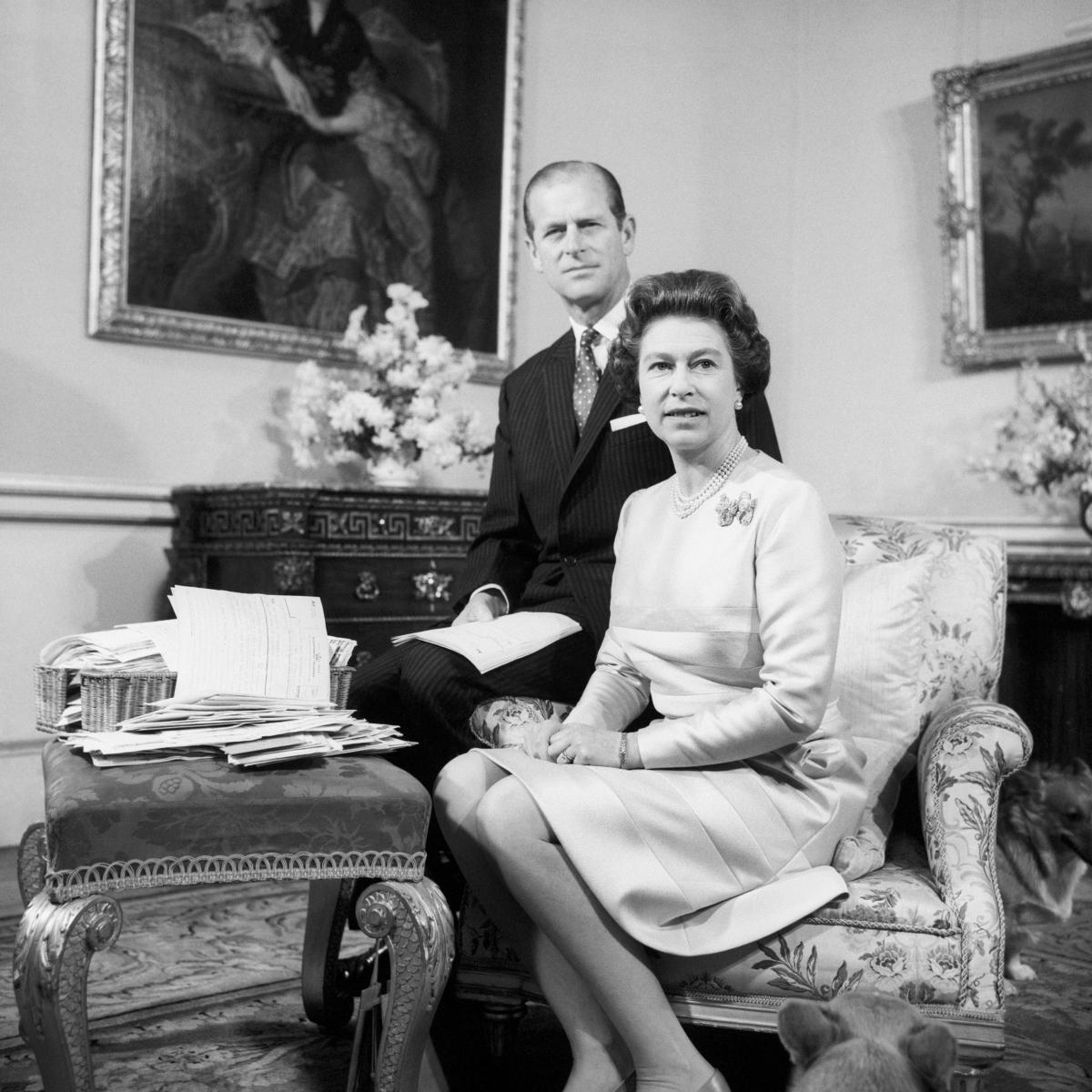 Queen Elizabeth II and the Duke of Edinburgh celebrating their Silver Wedding Anniversary in the Belgian suite in Buckingham Palace Photo (C) GETTY
