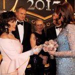 The Dame and the Duchess Joan Collins and Kate shake hands after the show Kates bouquet of roses almost matches Joans dress perfectly