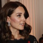 The Duchess of Cambridge accessorised with a pair of glittering teardrop earrings, pictured, and wore a poppy pin