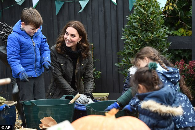 The Duchess of Cambridge donned her gardening gloves and joined children as she visited Robin Hood Primary School to celebrate ten years