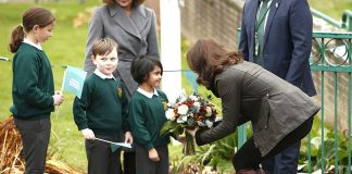 The Duchess of Cambridge was welcomed with a Christmassy flower arrangement as she arrived at Robin Hood Primary School in London
