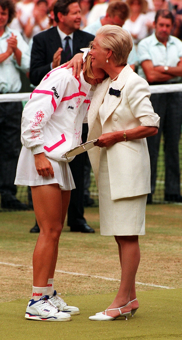 The Duchess of Kent comforts Jana Novotna as she presents her with the runner up trophy on centre court at Wimbledon in 1993 Photo C AP