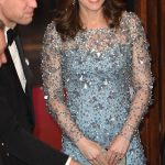 The Duchess smiled warmly at guests as her husband the Duke of Cambridge shook hands with attendees