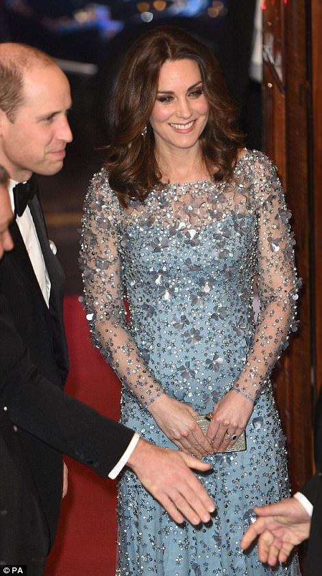 The Duchess smiled warmly at guests as her husband, the Duke of Cambridge shook hands with attendees
