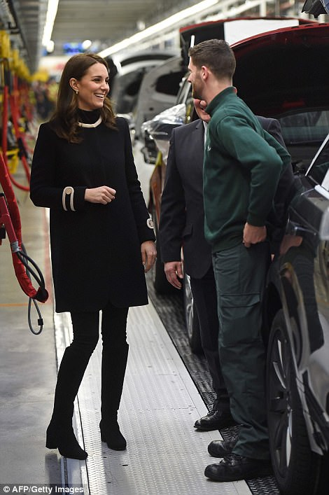 Today Kate donned a cosy polo neck jumper underneath the collarless coat to keep warm