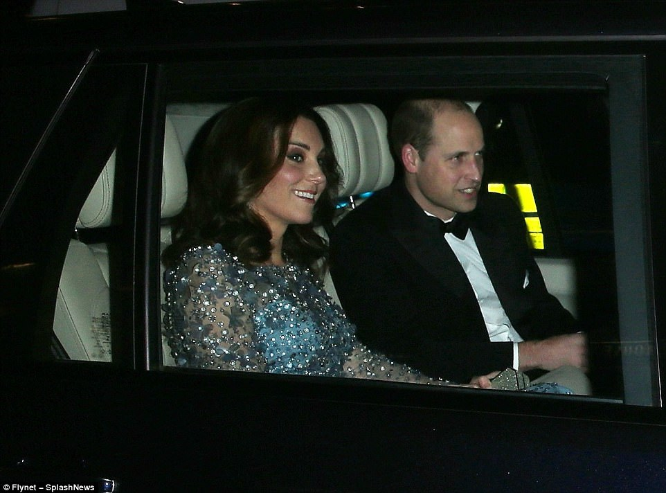 The Duke and Duchess of Cambridge smiled as they drove through central London to attend the show tonight