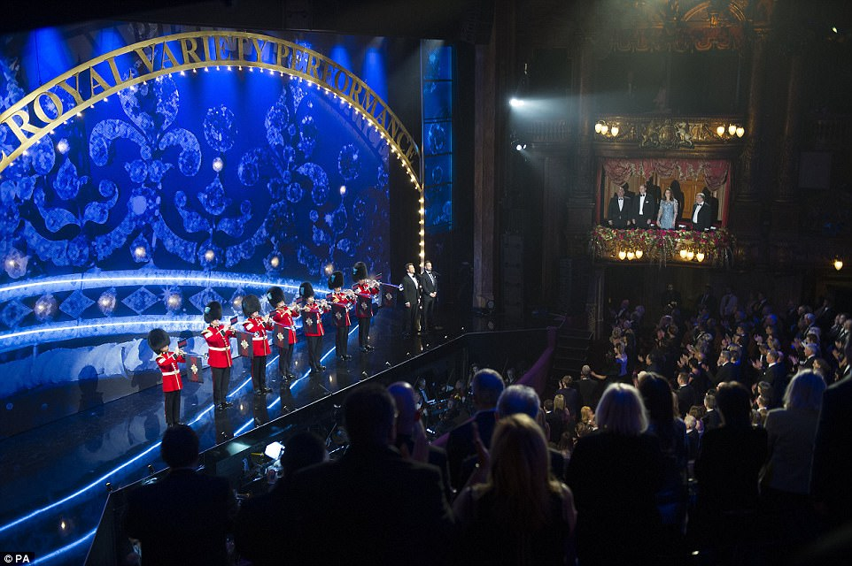 The Duke and Duchess of Cambridge were illuminatd in the Royal Box (right) as they attended the Royal Variety Performance