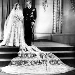 The Queen wore the ivory silk gown with a satin train which was encrusted with 10000 seed pearls Photo C GETTY