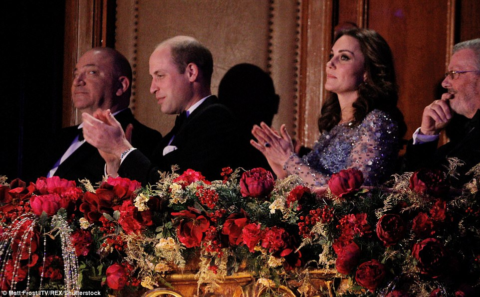 The couple clapped as a variety of performers took to the stage, including Miranda Hart, The Killers and Louis Tomlinson