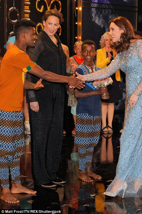 pictures show there were no hard feelings as Will and Kate warmly shook hands withe Miranda and other performers after the show in the London Palladium theatre