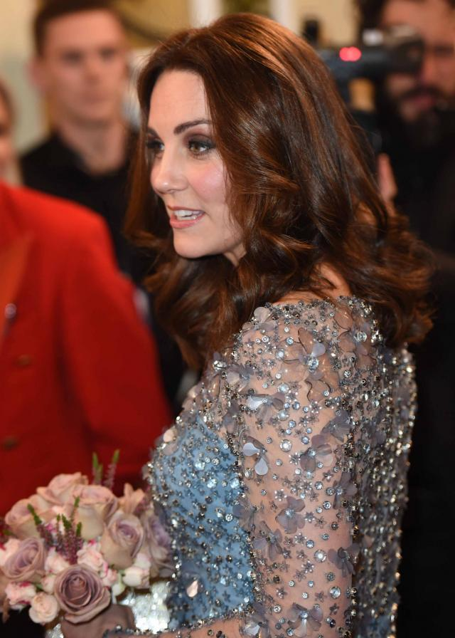 Kate was handed a bunch of flowers as she arrived at the performance (Getty Images)