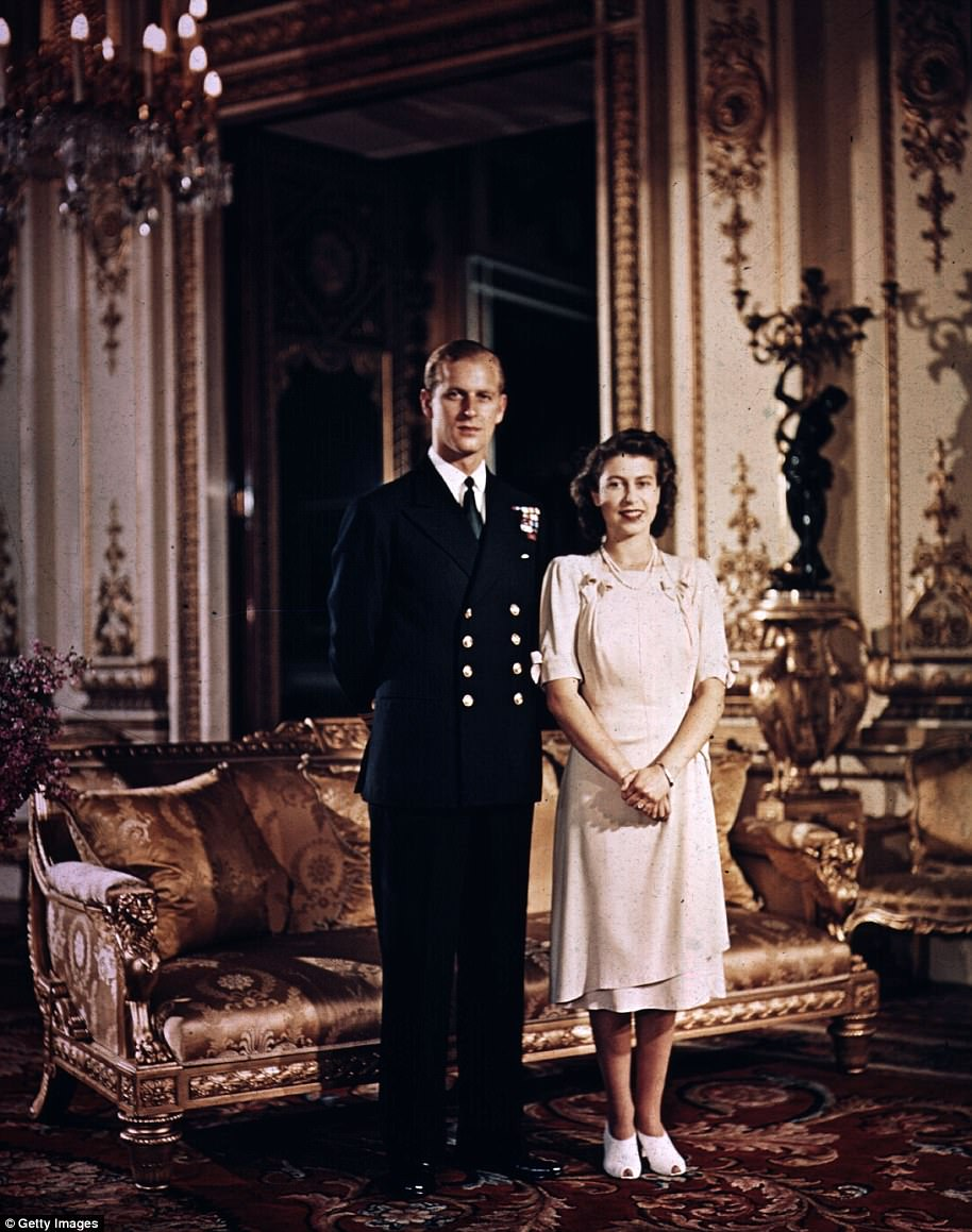 1947: A then Princess Elizabeth stands with Prince Philip at Buckingham Palace in a very stiff pose, while the couple are smiling there is no body contact whatsoever