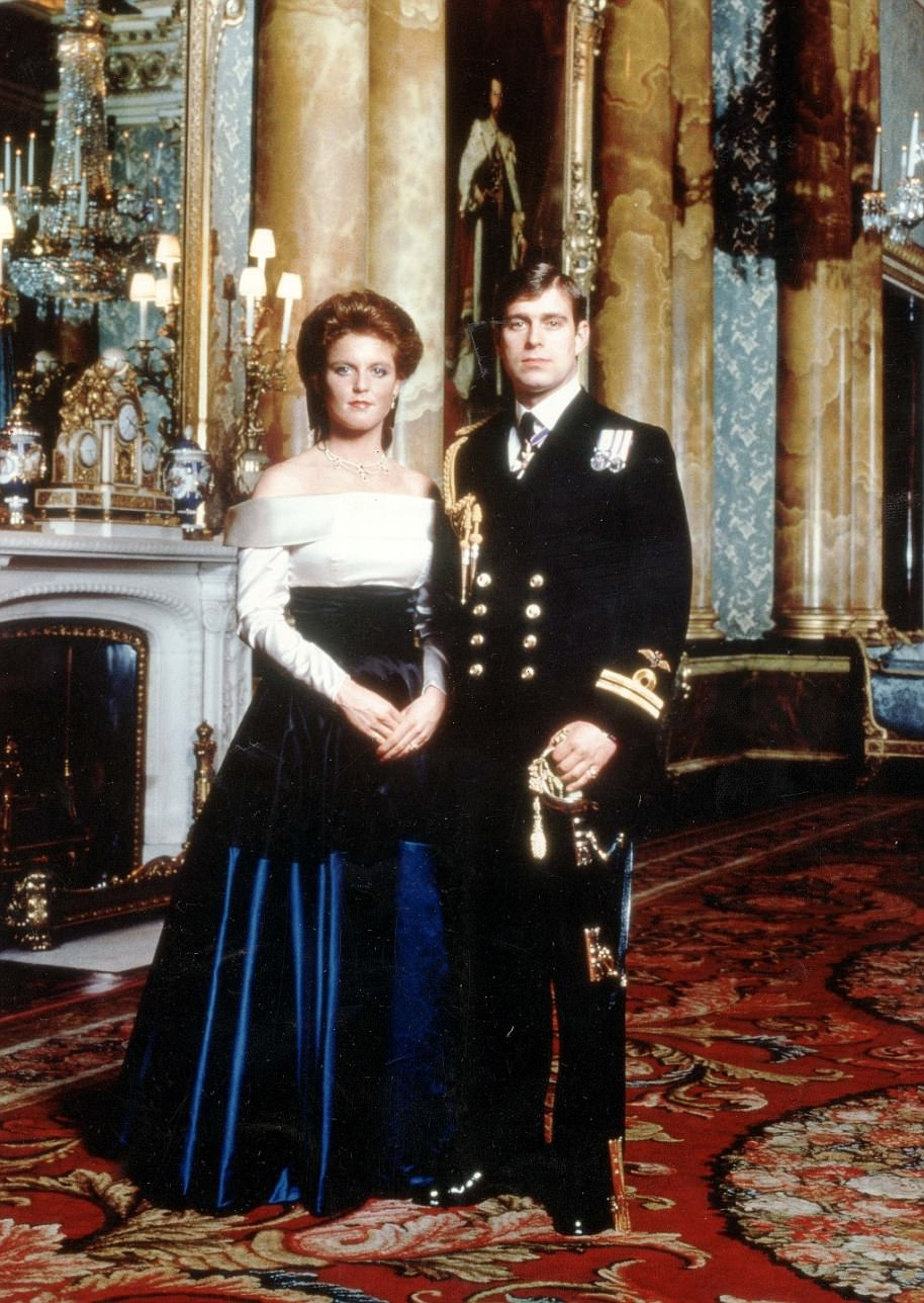1986: Prince Andrew and Sarah Ferguson's engagement photo was typical of the era it was shot in. Fergie's hair lived up to the (literally) high standards of the decade and she wore an outlandish three-tiered evening dress in white, black and royal blue. Prince Andrew wears the ceremonial day dress uniform of a naval lieutenant. The pair barely cracked a smile as they posed for photos in Buckingham Palace