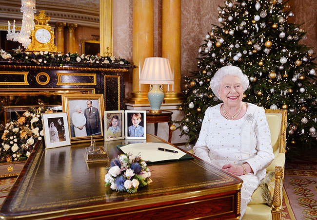 Prince Harry and Meghan Markle's engagement photo call picture takes pride of place at Queen's palace Photo (C) GETTY IMAGES