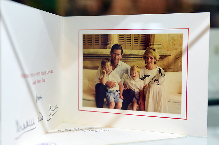 A 1987 Christmas Card signed by Prince Charles and the late Princess Diana is among items beside dresses on display at Julien's Auction House in Beverly HIlls, California on December 1, 2014, ahead of the December 5th and 6th auction of Items belonging to the late Princess. AFP PHOTO/Frederic J. BROWN        (Photo credit should read FREDERIC J. BROWN/AFP/Getty Images) Photo: © Getty Images