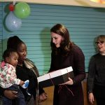A youngster looked delighted to be receiving a present from the royal visitor
