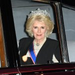 Camilla stunned in a white lace gown which was paired a four string pearl necklace fixed with a diamond clasp
