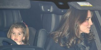 Charlotte who was dressed in a burgundy cardigan looked sleepy as she was driven home