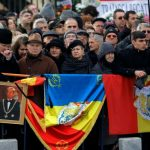 Crowds wait to see the coffin pass by during the state funeral. Credit AP