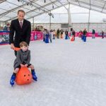 Heirs on ice Prince William takes his young son for a spin around the rink on a festive day out