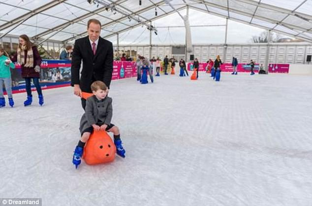 Heirs on ice! Prince William takes his young son for a spin around the rink on a festive day out