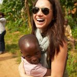 Images of Meghan cuddling children in Rwanda are very reminiscent of Diana Photo C PA