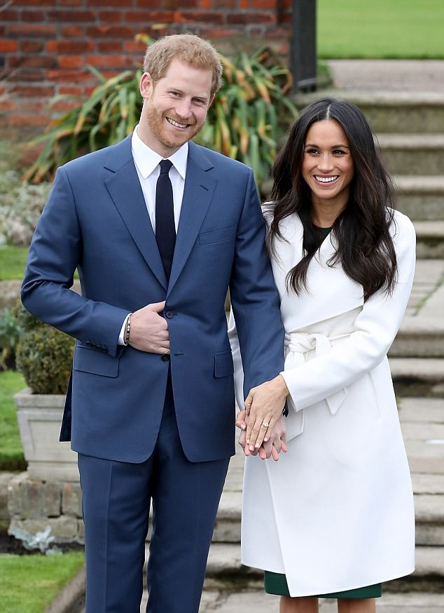 2 Prince Harry and Meghan Markles engagement photo call picture takes pride of place at Queens palace Photo C GETTY IMAGES