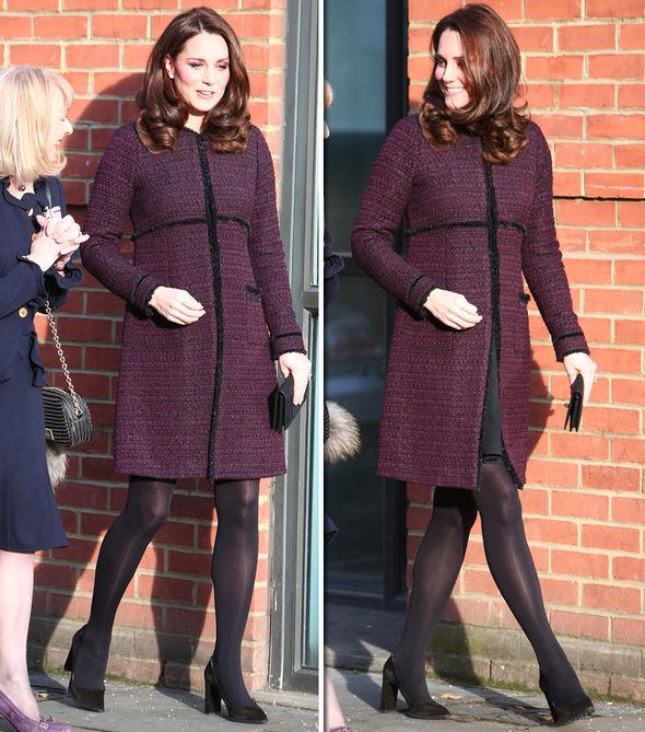 Kate Middleton Bump looks bigger than ever in a stunning festive dress Photo C JOHN RAINFORD WENN