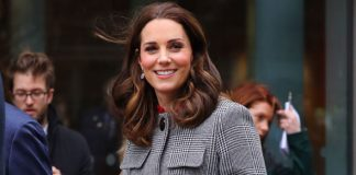 Kate, who is pregnant with the couple's third child, showed off a grey LK Bennet coat costing £495 Photo (C) KARANI TANG
