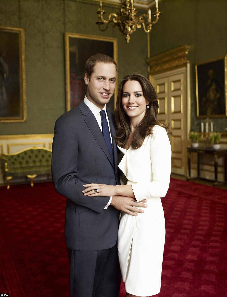 Meanwhile the the Duchess of Cambridge opted for a dress from high street retailer Reiss as she and William posed in the Council Champer in the State Apartment of St James's Palace