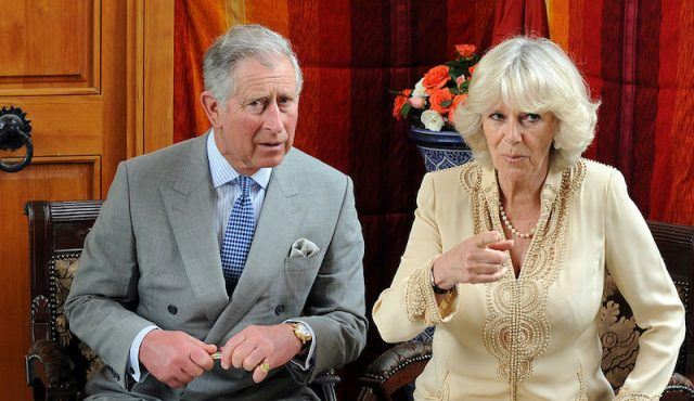 Prince Charles sits next to Camilla during an interview.