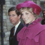 Prince Charles and Princess Diana walk side by side. Photo (C) GETTY